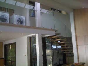 Beam cladding and glass installations